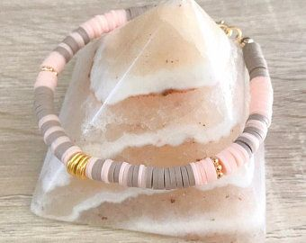 Bracelet washes heishi, cabochon onyx black and plated gold 24 k