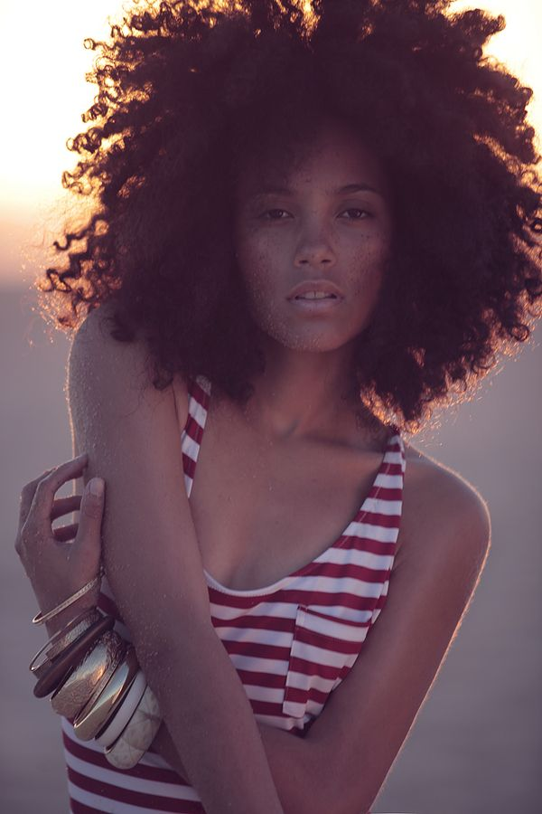 beautiful big hair, lovely lady, natural light. everything about this is right.