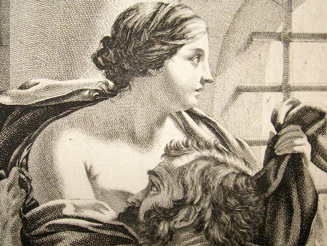 Man suckling womans breast