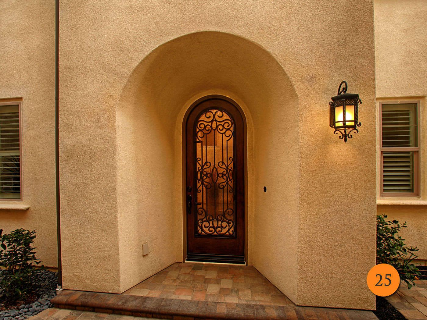 Entry doors gallery 2 todays entry doors palo santo designs rustic style x sized single entry fiberglass door jeld wen aurora model full glass arched top door with exterior wrought iron grille planetlyrics Images