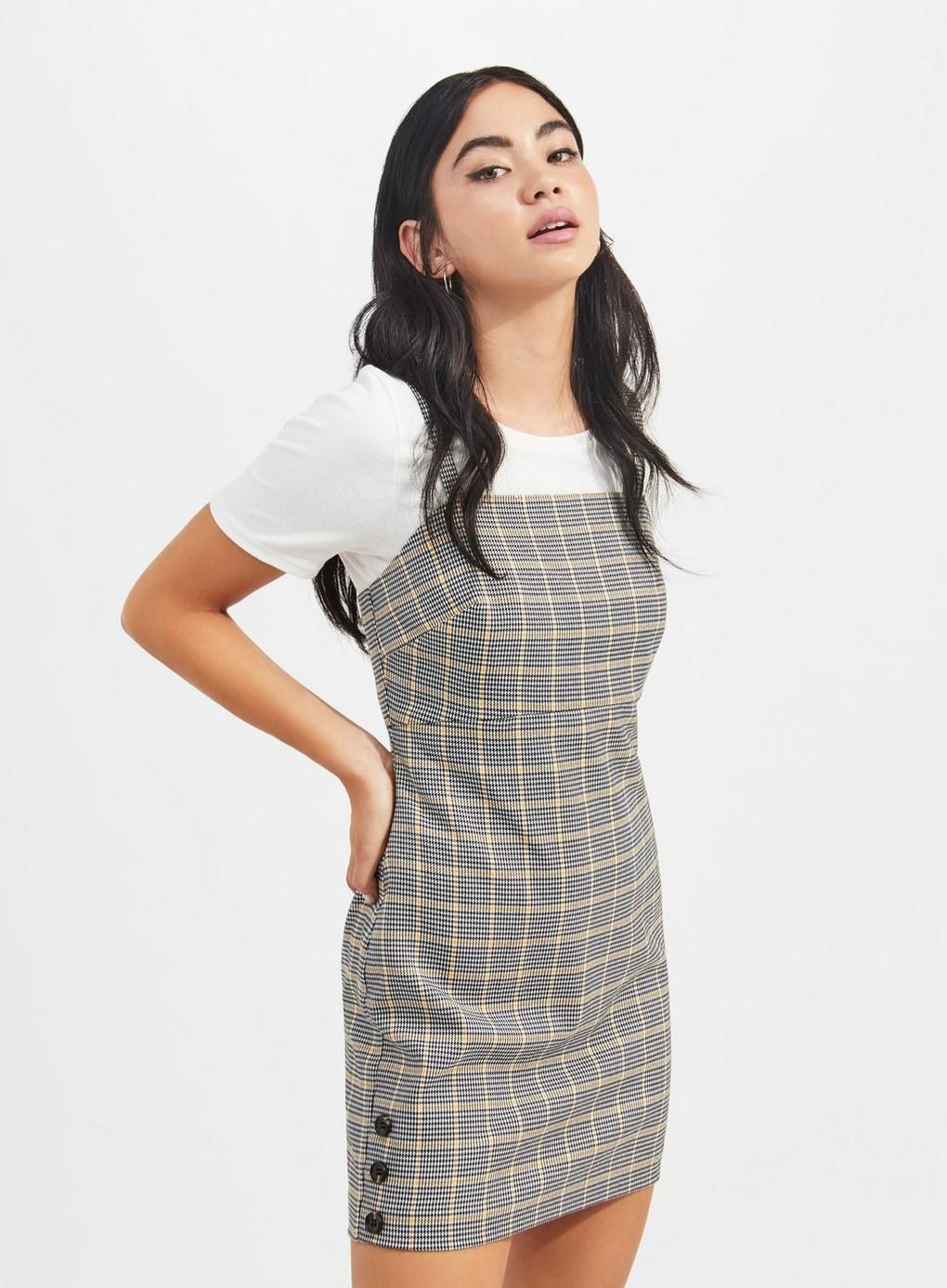 7cbef74c3d strappy yellow check pinafore dress is the perfect layering piece this  season.