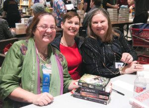 Adrienne with Patricia Briggs (left) and Anne Bishop (right) at Sci-Fi Authorfest 7. Photo courtesy of Adrienne.