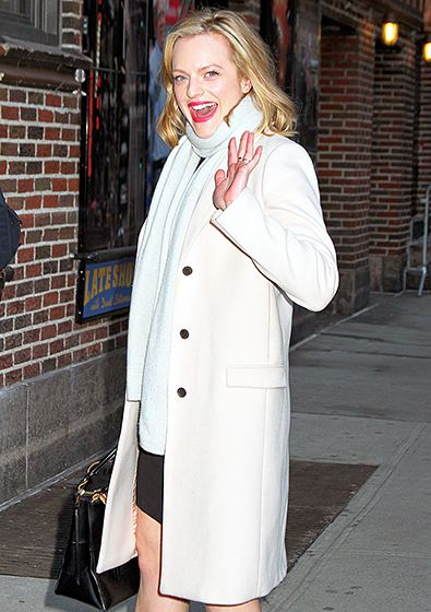Elisabeth Moss waved arriving at the Late Show With David Letterman's studios in midtown NYC Feb. 11.