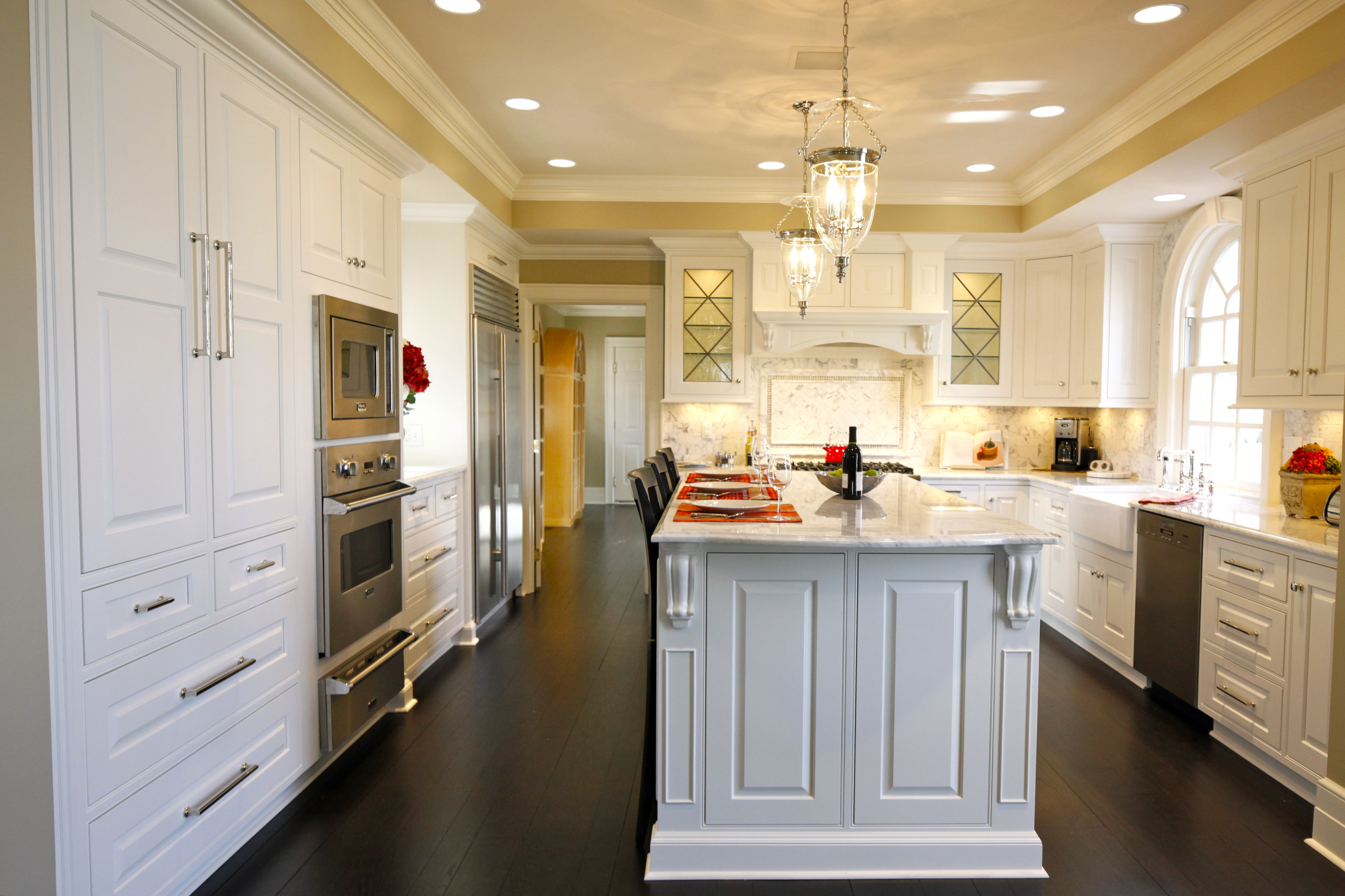 This Classic Columbus Ohio Kitchen Has White Marble Countertops A Marble Backsplash Dark Classical Kitchen Custom Kitchen Cabinets Stained Kitchen Cabinets