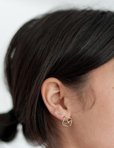 kathleen whitaker, genius designer of the dot and dash earrings we have all become addicted to, is getting crazy with her dashes. I need 3 more piercings to fit them all!
