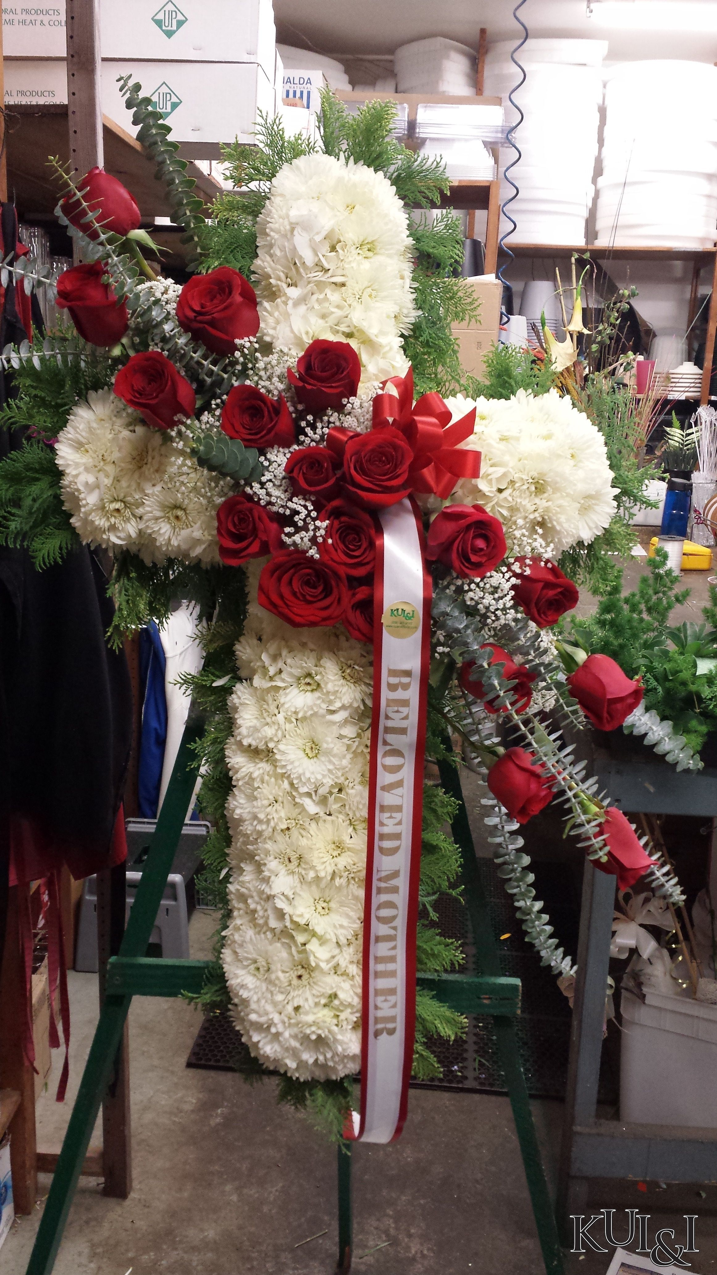 White Cross Funeral Standing Spray With Rose Accents Kuiandiflorist