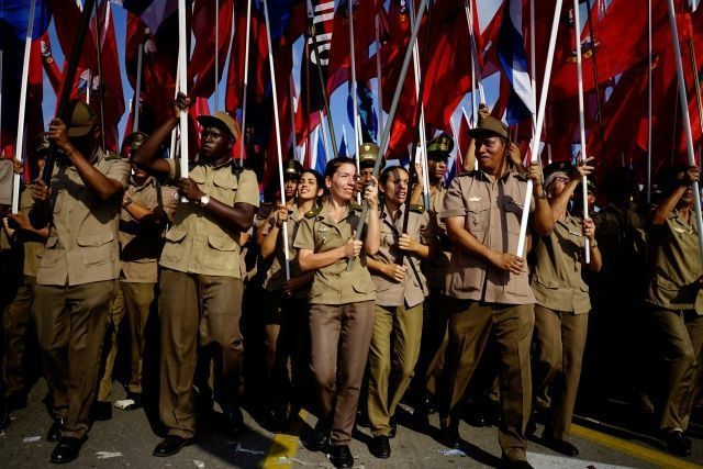 In Show of Continuity, Castro Flanks New Cuban Leader at May Day Rally - Army soldiers carry flags during the May Day rally in Havana, Cuba, May 1, 2018. REUTERS/Alexandre Meneghini #cubanleader In Show of Continuity, Castro Flanks New Cuban Leader at May Day Rally - Army soldiers carry flags during the May Day rally in Havana, Cuba, May 1, 2018. REUTERS/Alexandre Meneghini #cubanleader In Show of Continuity, Castro Flanks New Cuban Leader at May Day Rally - Army soldiers carry flags during the