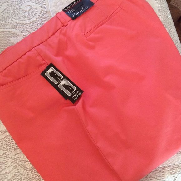 "Coral Capris [Tummy Control] Color listed as 'Coral Coast'. Beautiful Vibrant Coral Shade. These are Women's 24W Average. Straight Leg. Sits at Waist. Tummy Panel. Inseam is 21"". 97% Cotton 3% Spandex. Trim: 90% Nylon 10% Spandex. Kim Rogers Pants Capris"