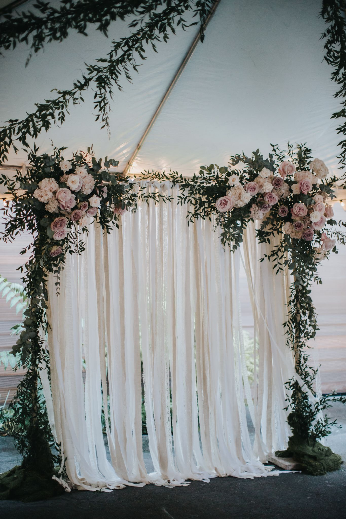 ethereal wedding ceremony arch idea greenery arch with blush flowers and ribbon backdrop
