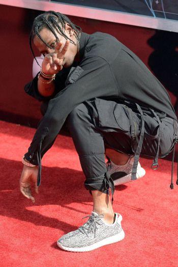 brand new aafc9 e2433 Celebrities Wearing Yeezy Boost Sneakers Travis Scott