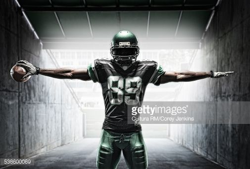 Stock Photo : Football player holding ball