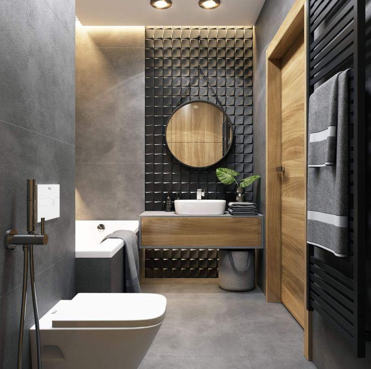 Photo of Stilvolles Badezimmer mit rundem Spiegel, betongrauer Wand und Boden …