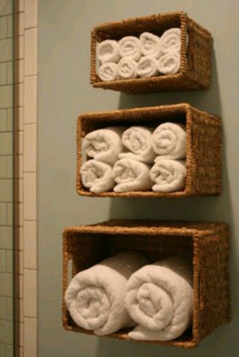 Organize The Towels By Hanging Baskets On The Wall In The Bathroom