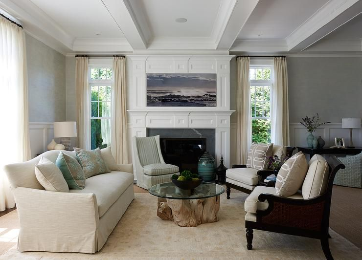 Under A Coffered Ceiling This Beautiful Earth Tone Living Room Boasts A Skirted Cream