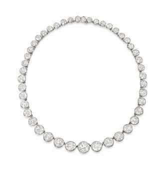 AN EARLY 20TH CENTURY DIAMOND RIVIÈRE NECKLACE   Composed of a graduated row of forty-five circular-cut diamond collets, joined by single link connections, 34.4cm long
