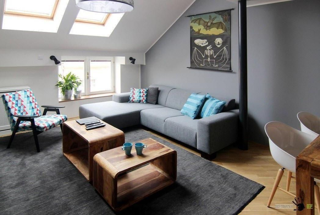 Modern Sectional Sofa With Pretty Armchair And Nice Wooden Tables In A  Small Attic Living Room