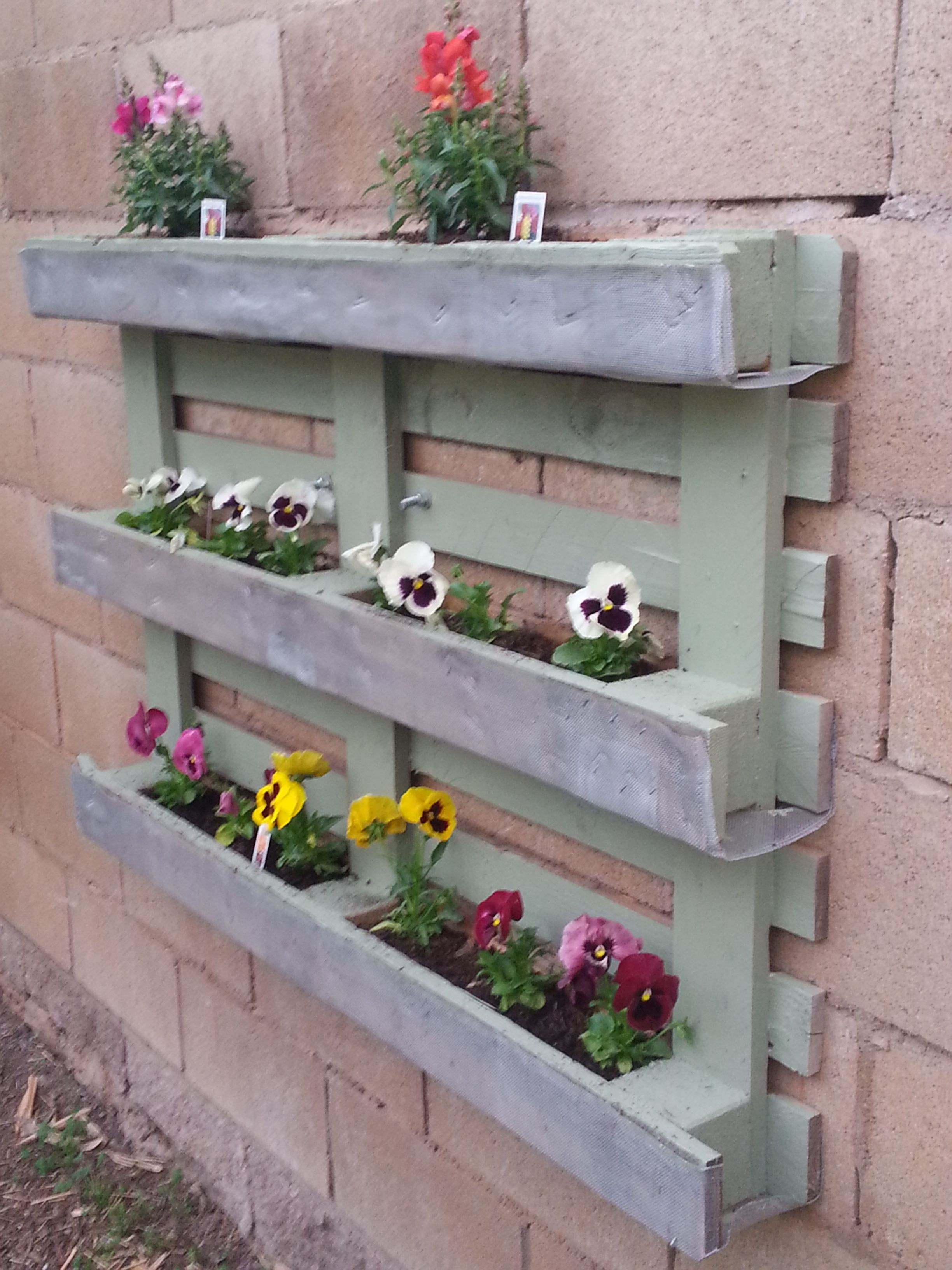Create a decorative flower box with a pallet, and staple