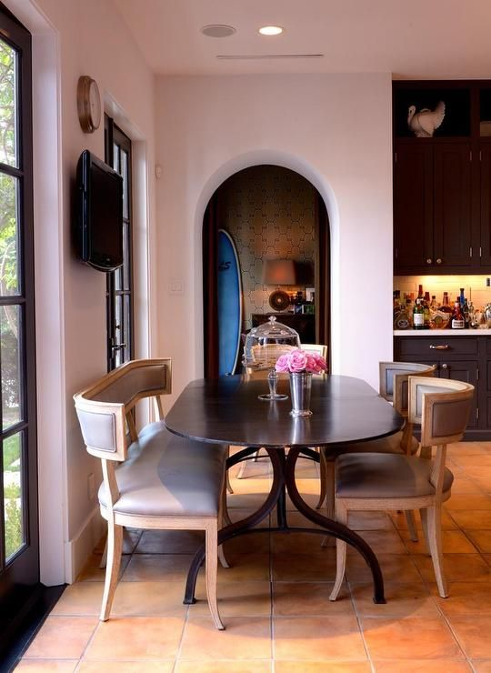 French Eat In Kitchen Features An Oval Dining Table Lined