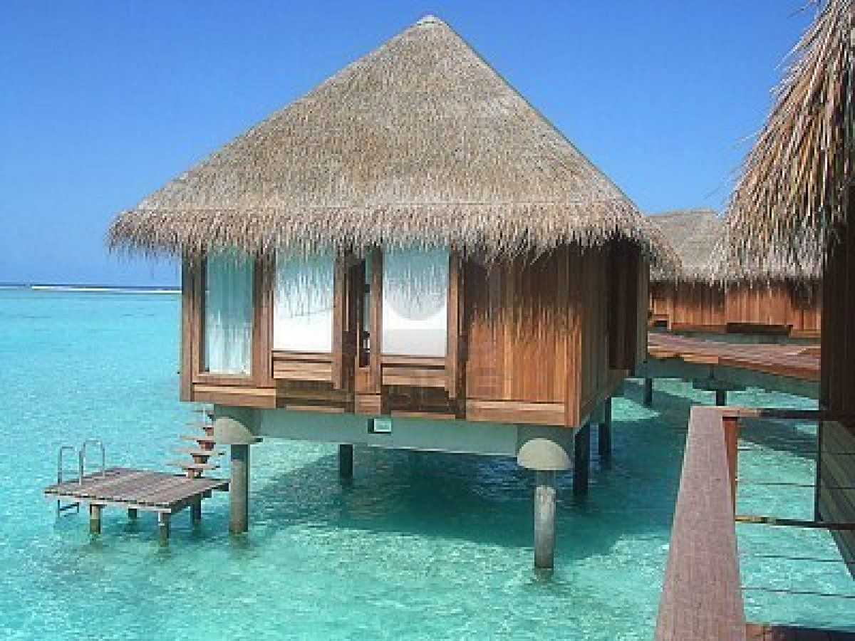 Over water Bungalow and the turquoise sea at the Maldives