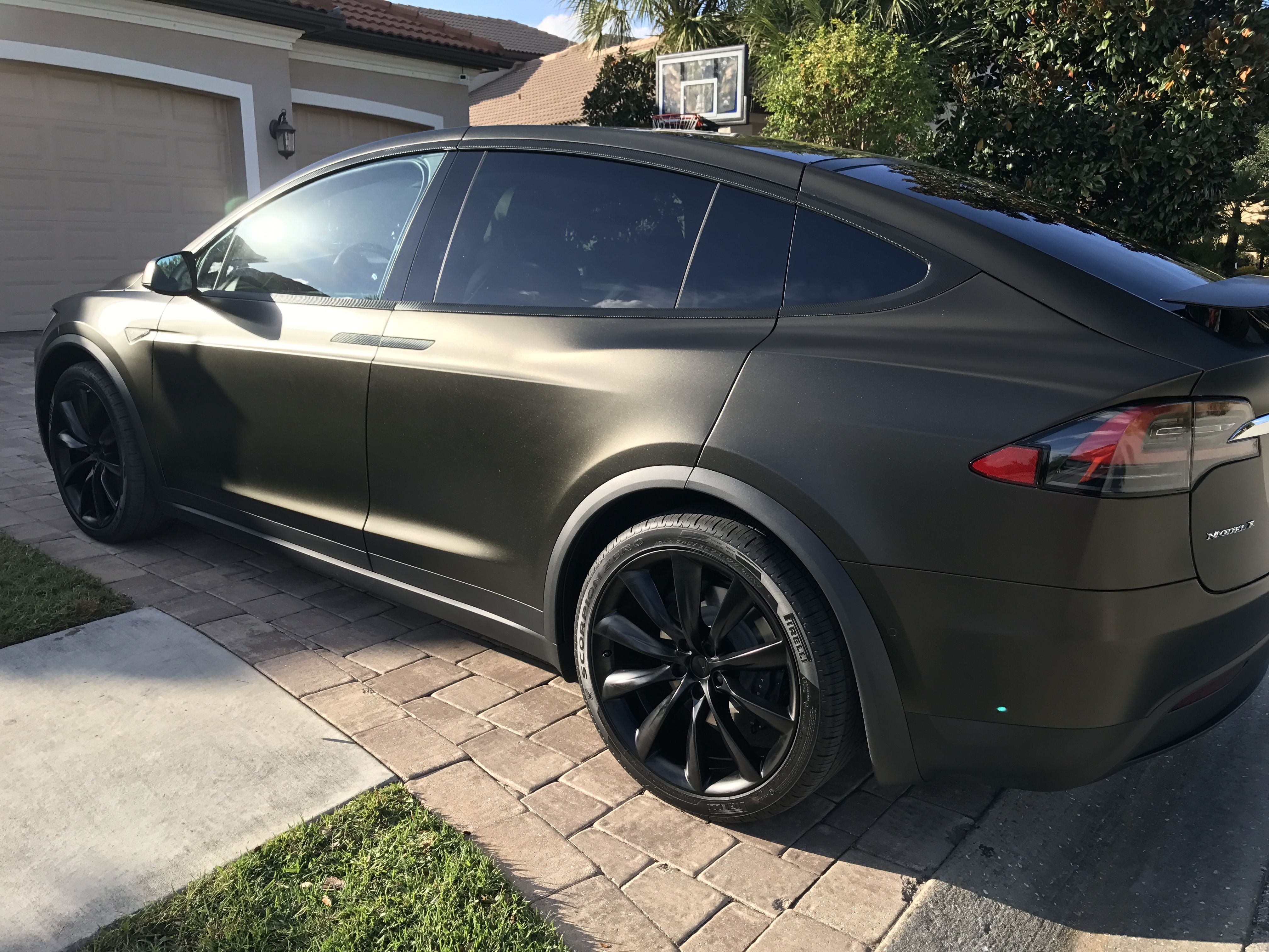 Tesla Model X Black Satin Gold Dust Vinyl Wrap With Carbon Fiber Accents On Chrome And All 6 Seat Backs Awesome Post Vinyl Wrap Car Tesla Model X Vinyl Wrap