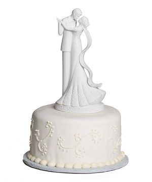 This elegant topper is a sweet addition to any wedding cake that can be preserved as a keepsake and handed down through the generations.