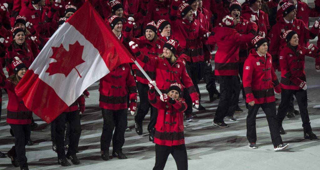 Team Canada Entering The Opening Ceremonies At 2014 Sochi Olympics Hayley Wickenheiser Captain Of The Wo Olympics Opening Ceremony Team Canada Canadian Girls