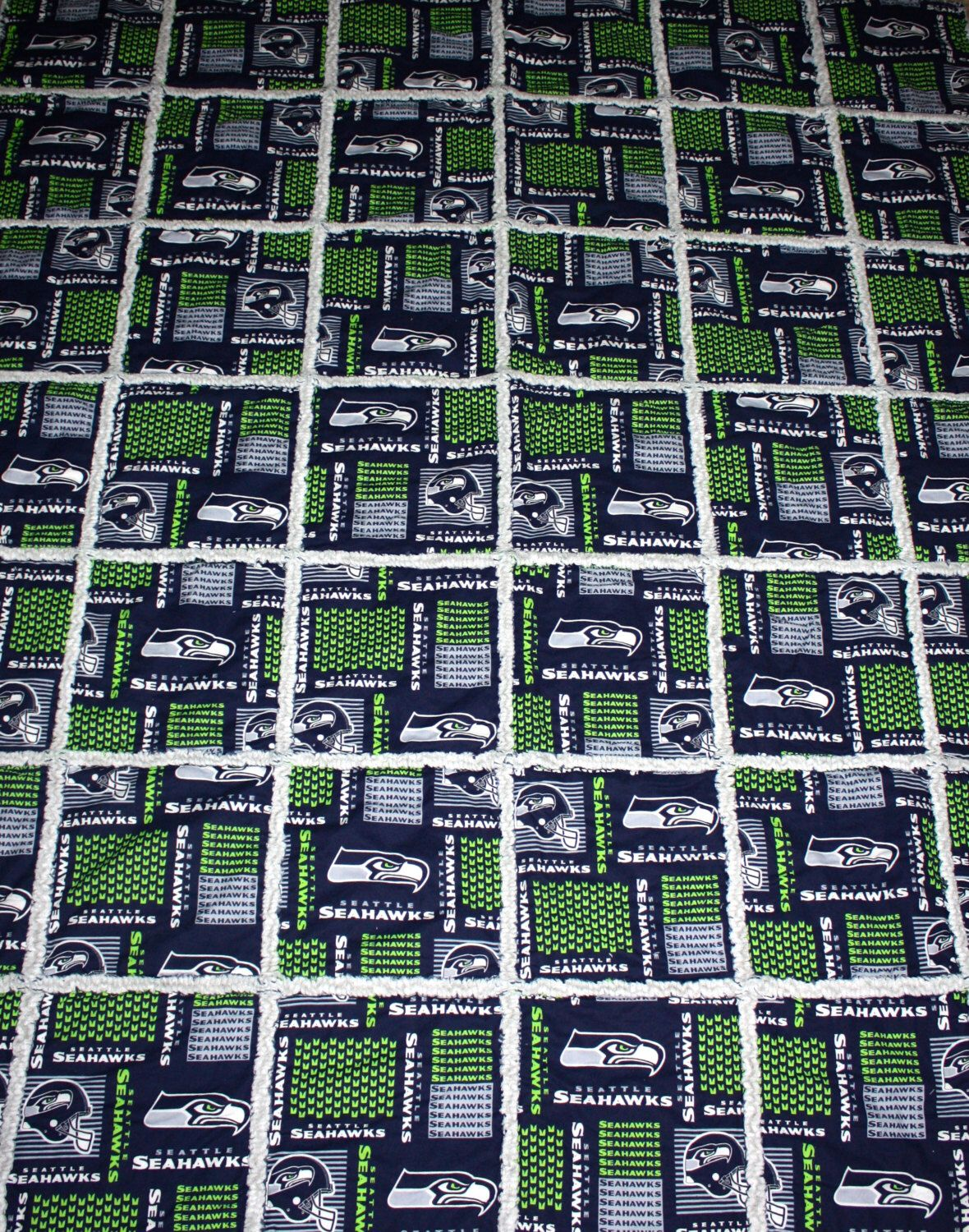 A personal favorite from my Etsy shop https://www.etsy.com/listing/220456964/rag-quilt-made-with-nfl-seattle-seahawks