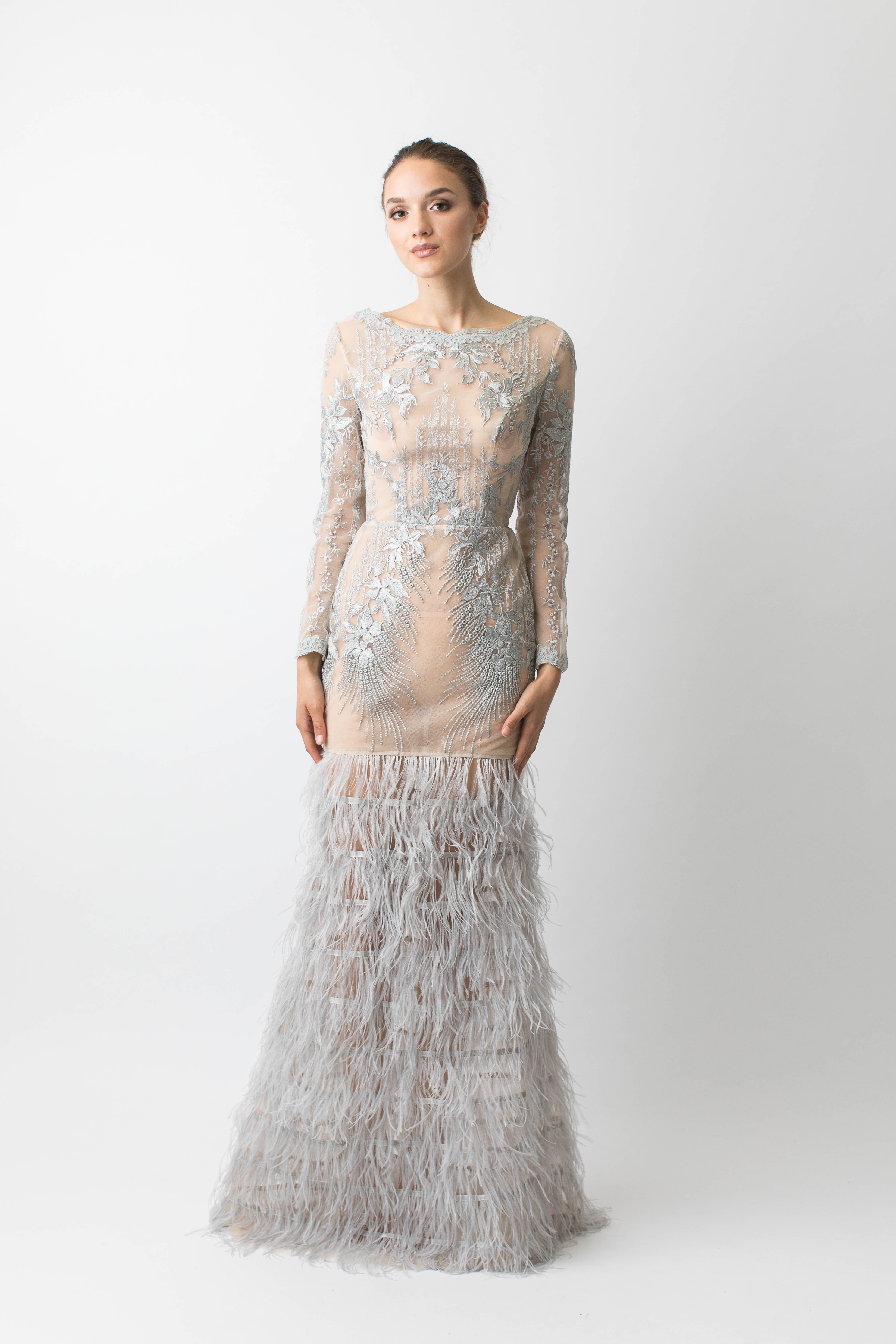Sheer silver lace embellished gown with feather skirt Made from a ...