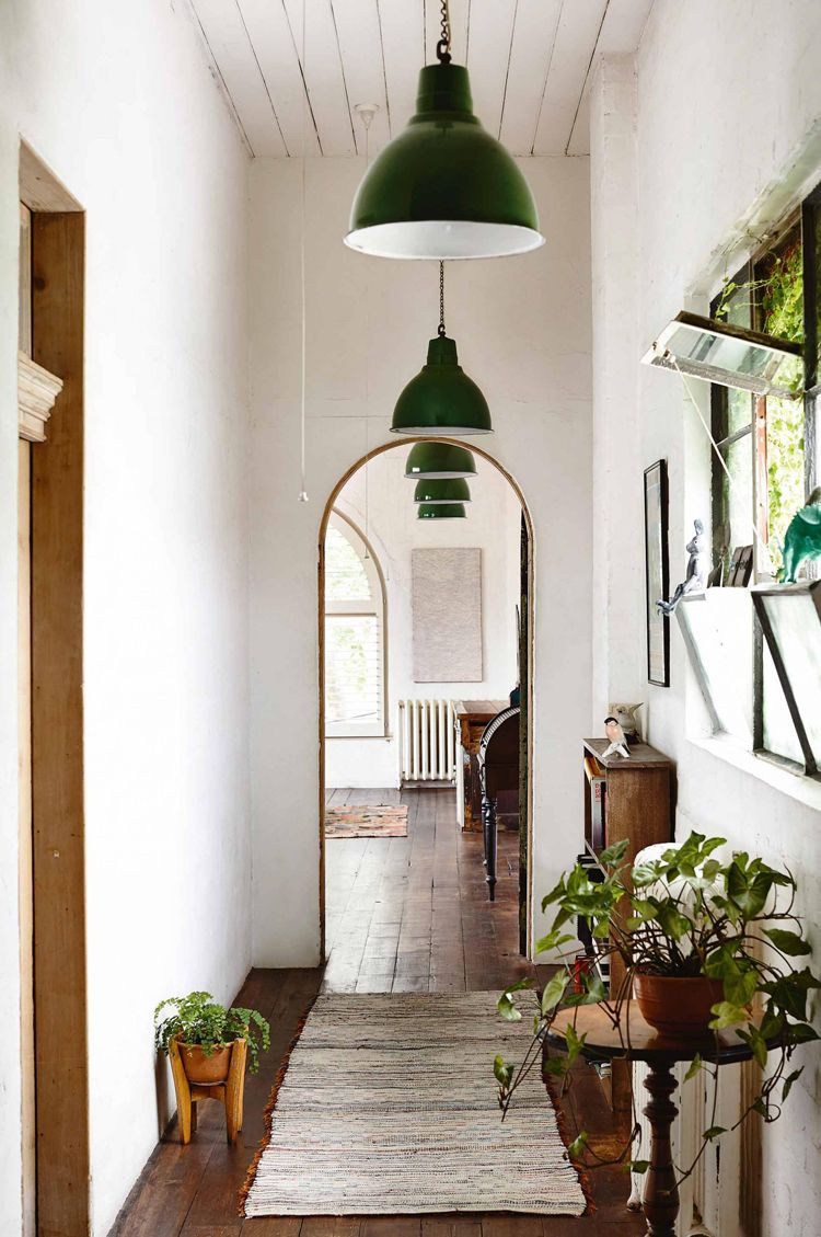 Black large pendent lights arch doorway plants for the home