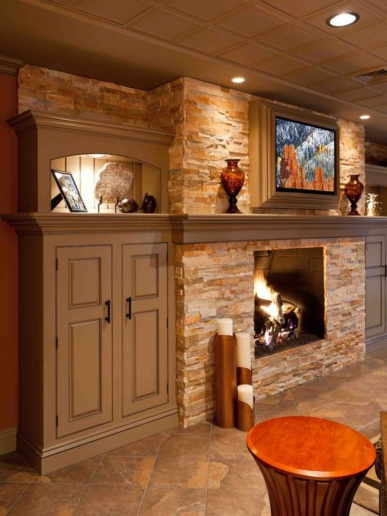 stacked stone fireplace/ lighted storage
