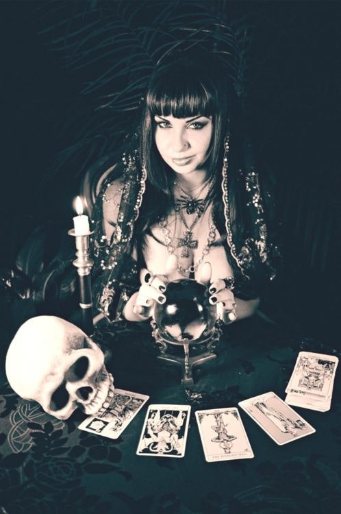 Divination: A fortune-teller with a crystal ball, skull, and