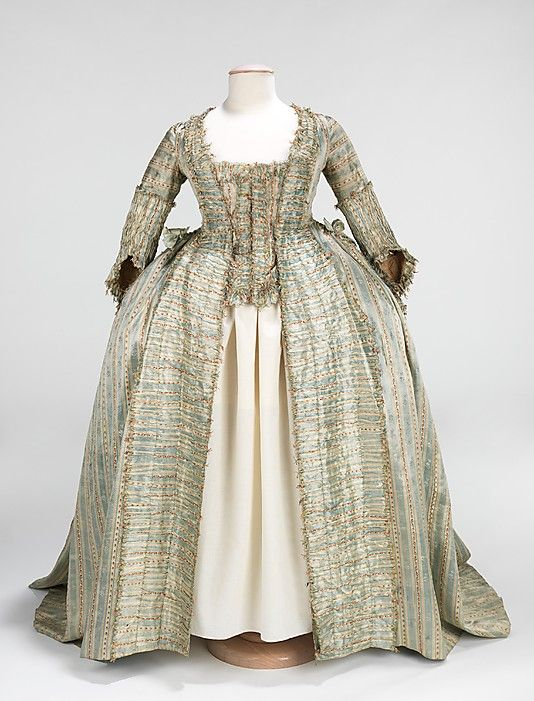 Robe à la Française, ca. 1780, French, silk. The striped textile here is indicative of the change in aesthetics around 1765 to a more neoclassical taste, less florid than the silks of the decades prior to them.