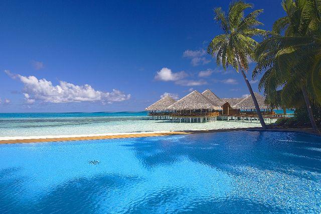 Water bungalows at Medhufushi Island Resort, Maldives.