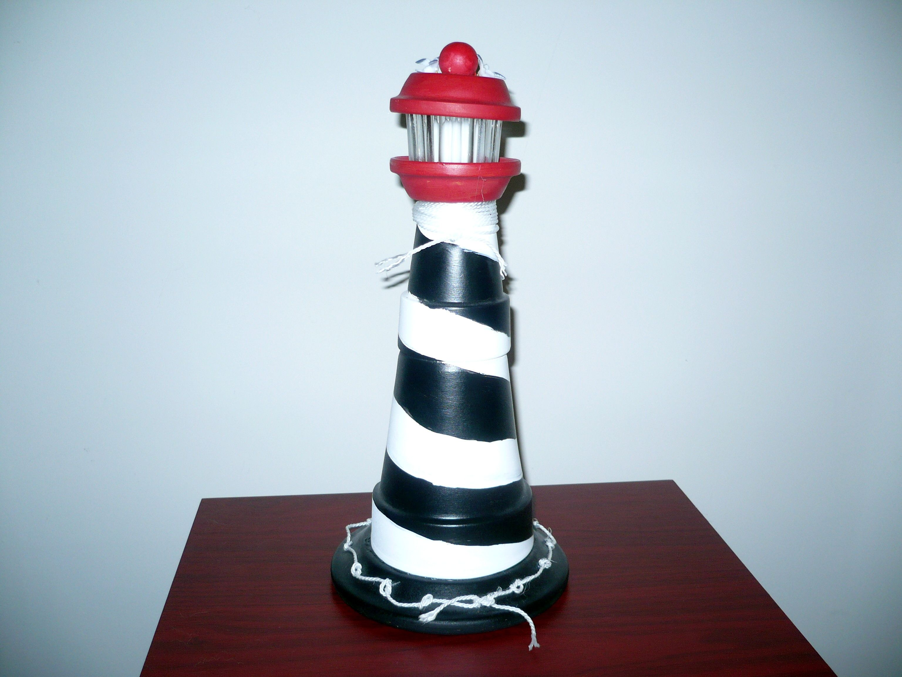 Diy make a clay pot lighthouse diy craft projects - Lighthouses Made From Terra Cotta Pots Can Do Very Large Yard Versions With Working Lights Clay Pot Craftsdiy