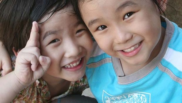 Two Children Smiling Starting The Global Movement One Smile At A