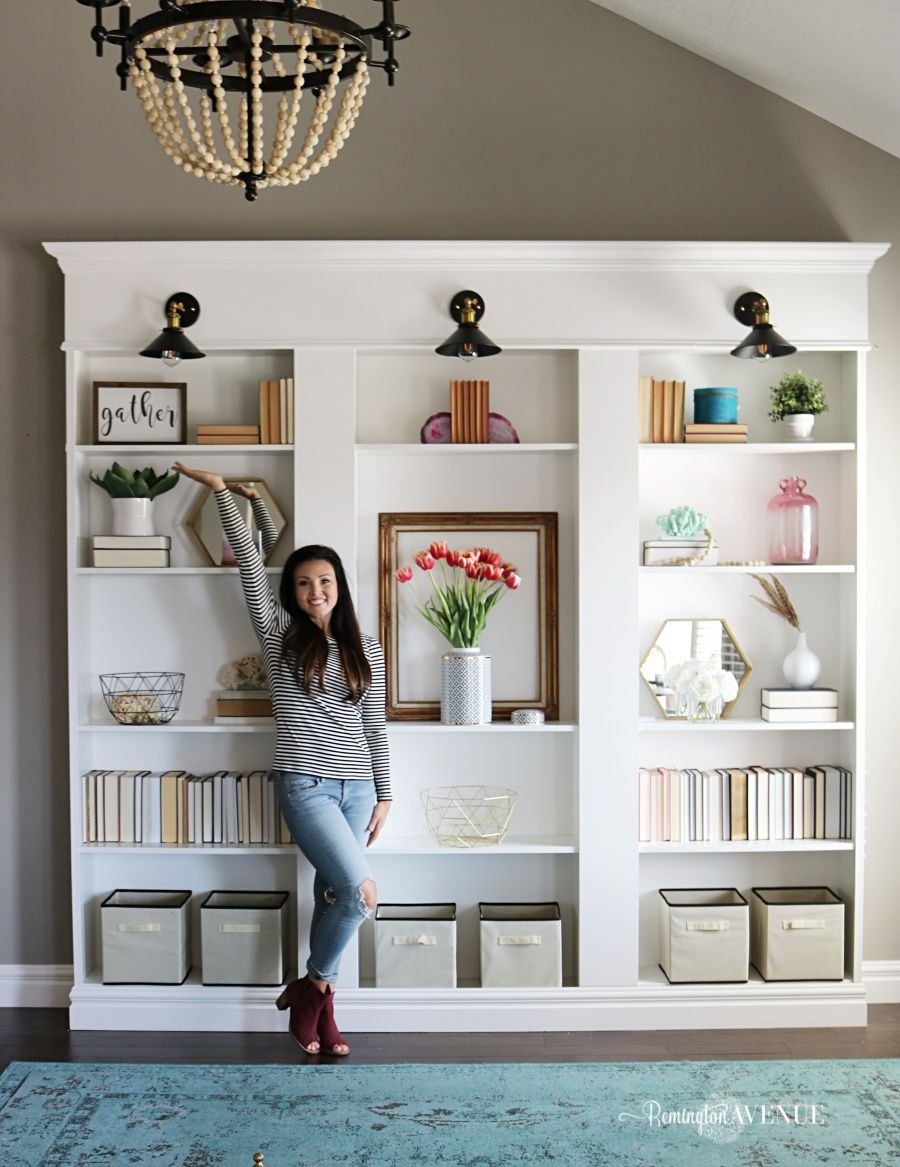 want to know how to build your own library wall i started with 3 ikea billy bookcases and modified them to look custom read on as i share all the details