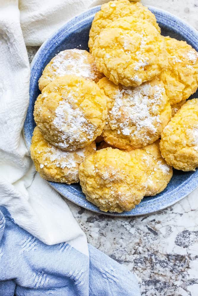 These Gooey Butter Cake Cookies are the BEST holiday cookie dessert recipe These St Louis style cookies are made with cream cheese butter and powdered sugar These sweet t...
