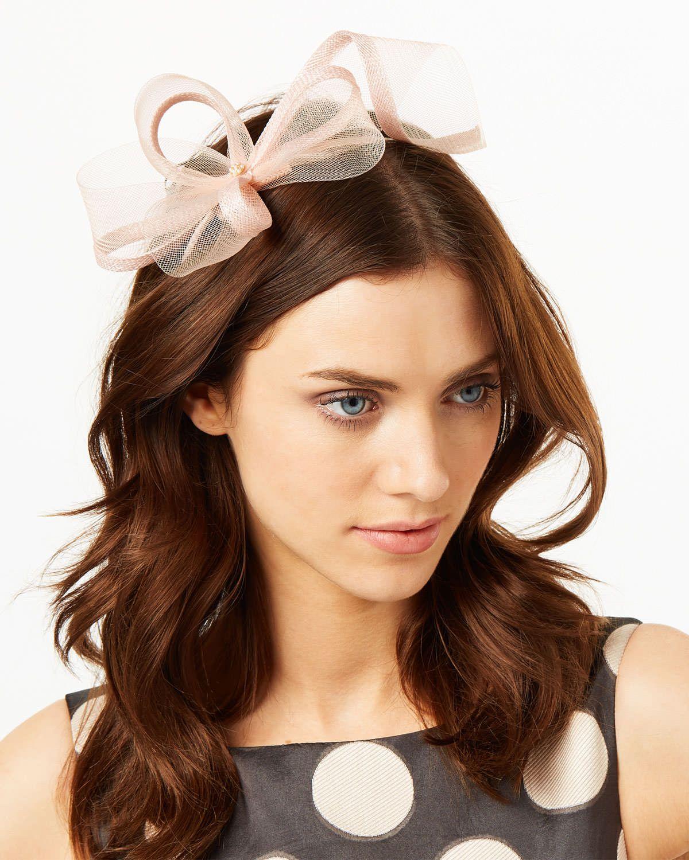 8fb692613f637 A mesh bow fascinator set in a slim headband. This elegant fascinator  offers a modern alternative to a hat.
