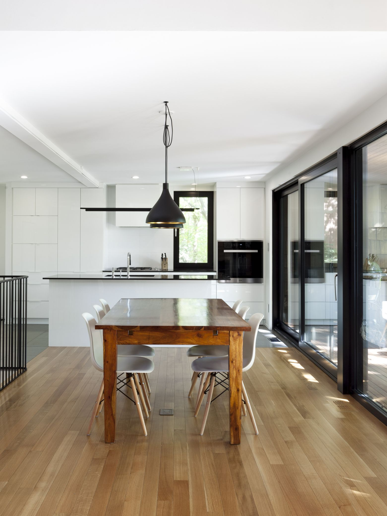 Dining Room And Kitchen Interior Design, White Walls, Wood Floors,