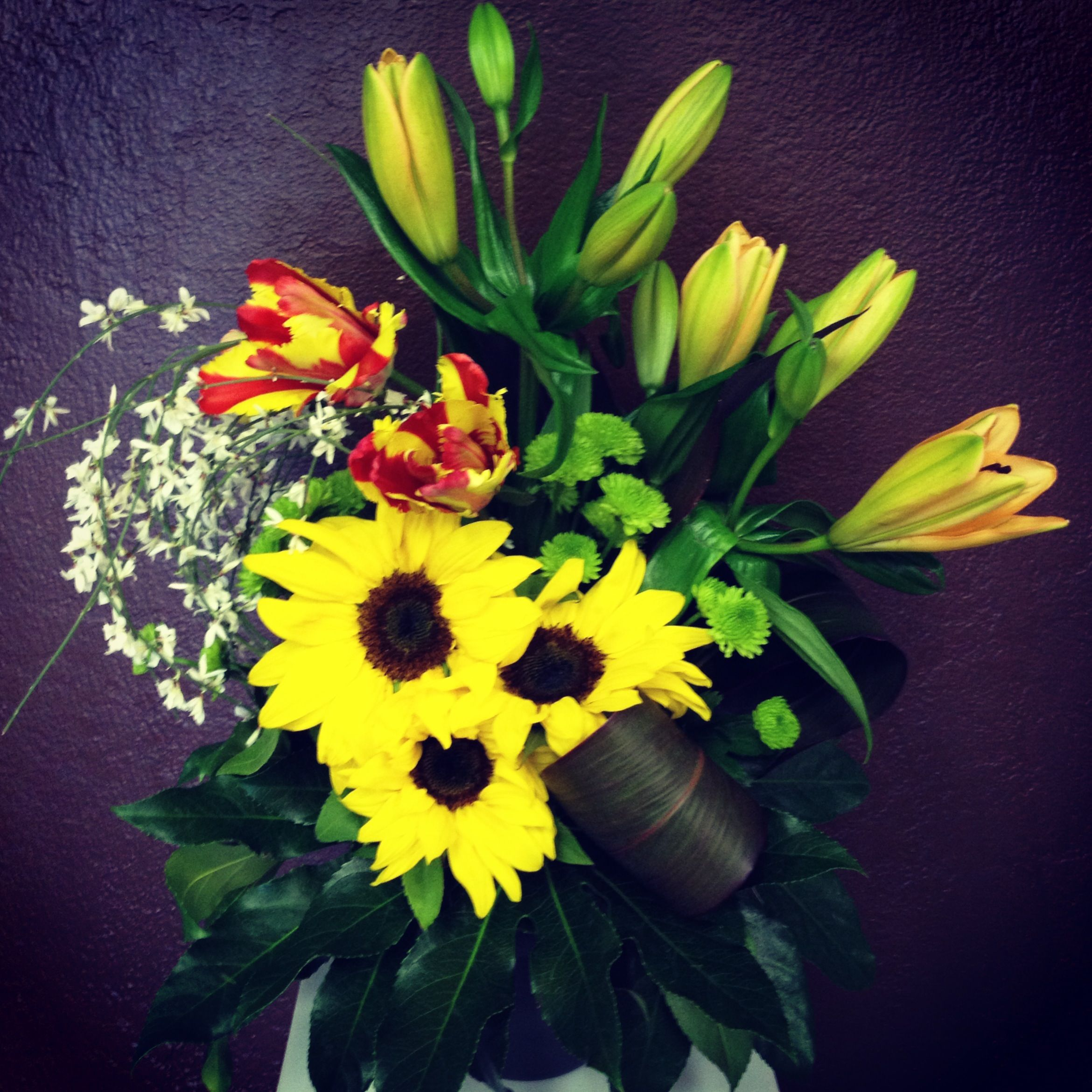 Sunflower, lilies and parrot tulips. Parrot tulips