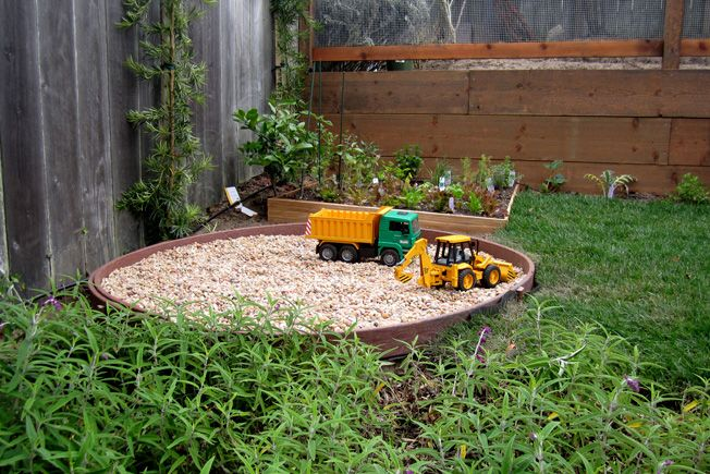 this is a great way to include an area for diggers which are an essential child friendly gardenkid - Garden Design Child Friendly