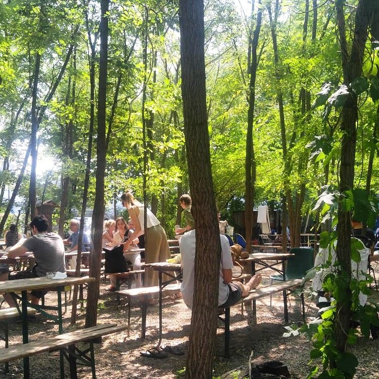 The Cafe Seating Area At An Urban Garden Located In Berlin