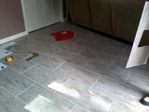 Trafficmaster Ceramica 12 In X 24 Groutable Vinyl Floor Tile From Home Depot The Concrete Style Looks Really And Great Reviews For 1 10 Sq Ft