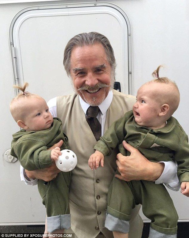 Don Johnson Grins Holding A Baby Who Looks Hilariously Shocked