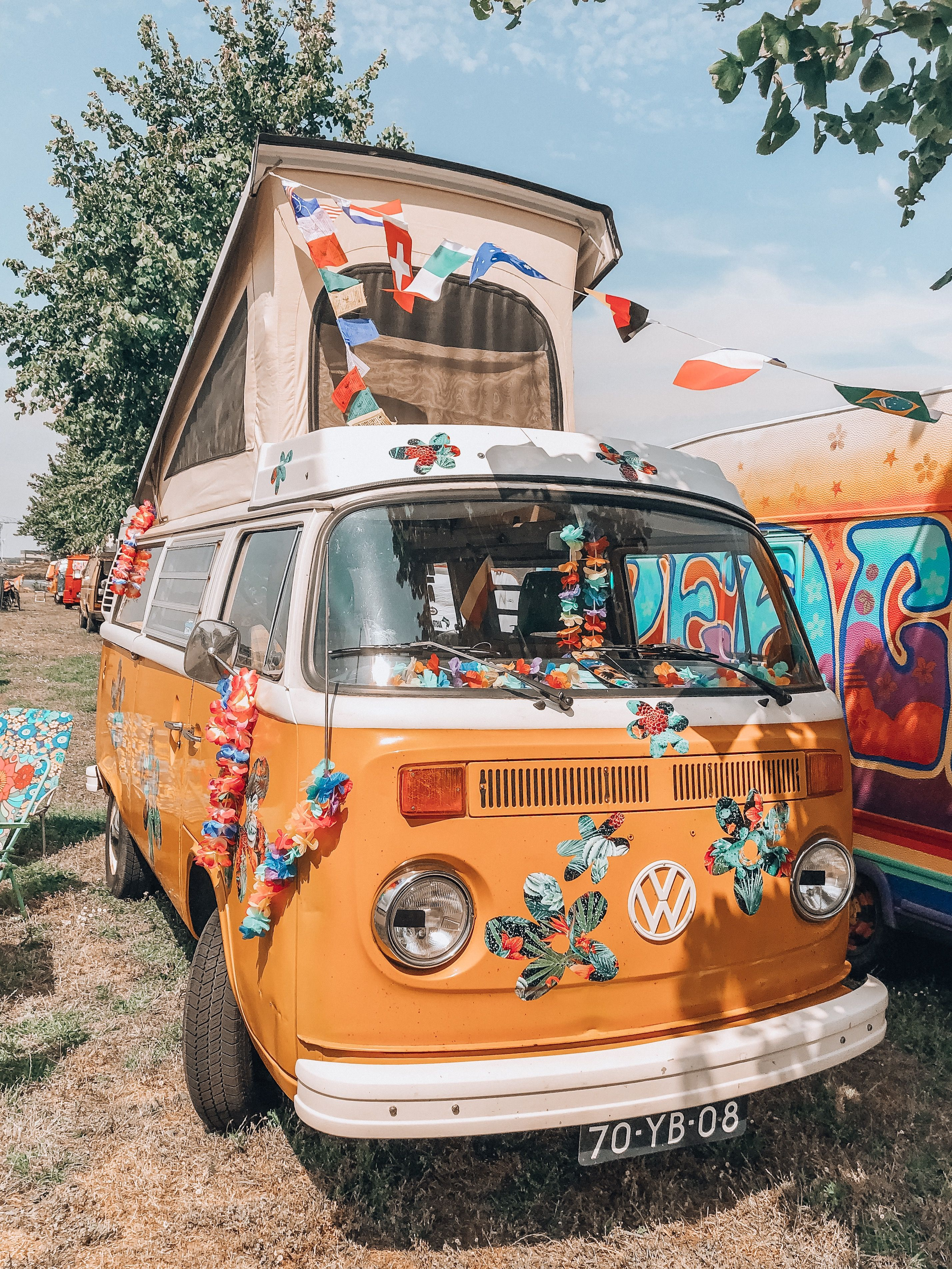 A hippie festival with VW busses