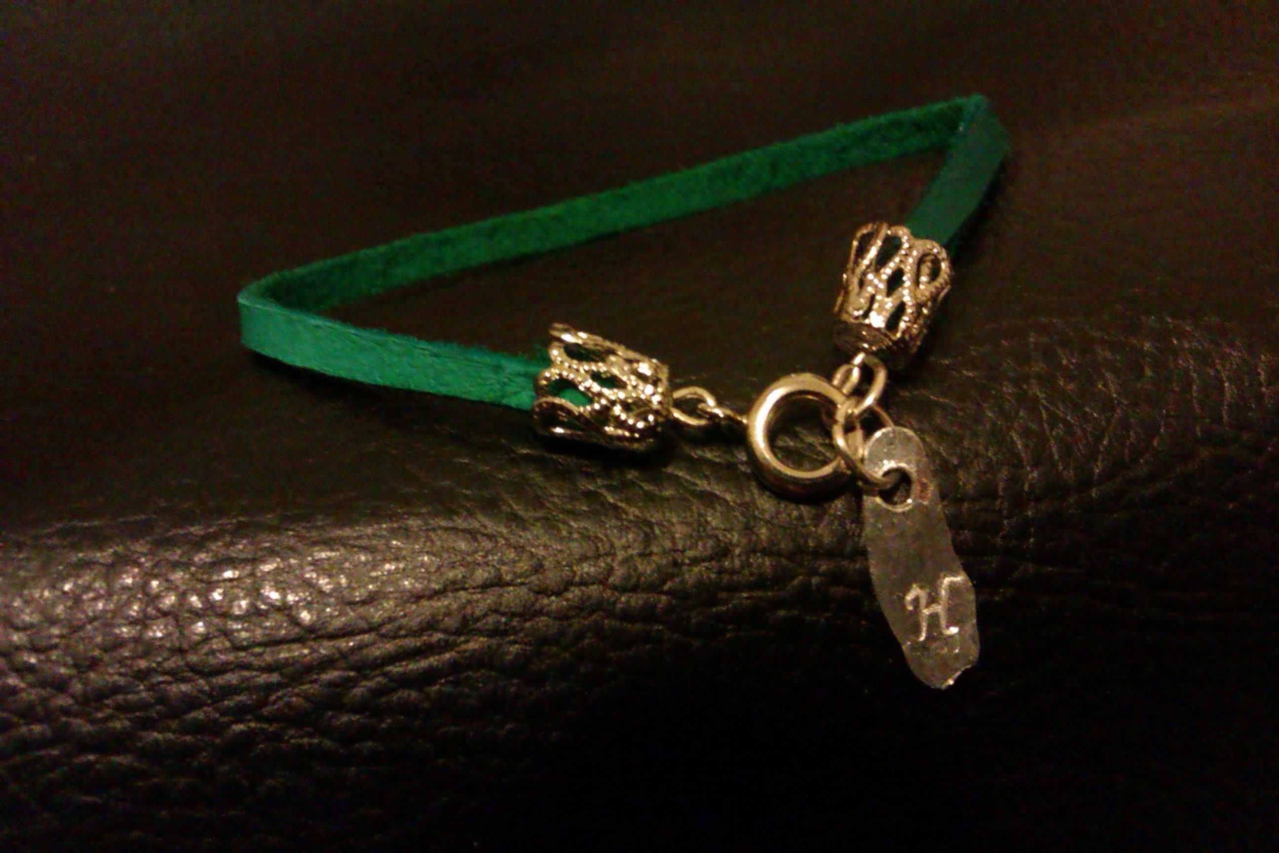 Green leather with monogrammed charm. -Haywood