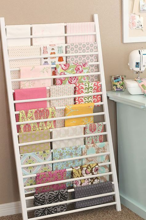 50 clever craft room organization ideas pinterest sewing notions diy craft room ideas and craft room organization projects crib side repurposed into fabric storage cool ideas for do it yourself craft storage fabric solutioingenieria Images