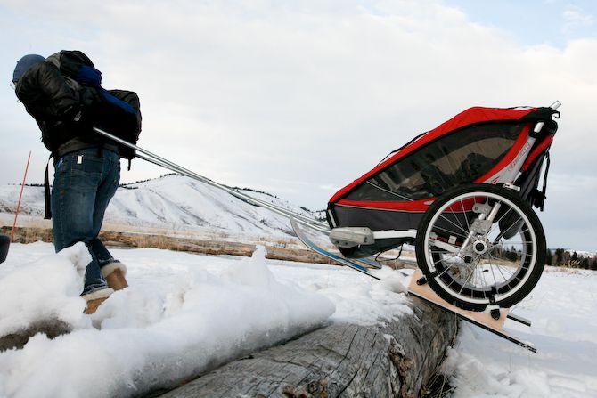 Rally Over A Log With The Homemade Chariot Ski Attachment Winter Fun Bike Trailer Baby Bike Trailer Child Bike Trailer