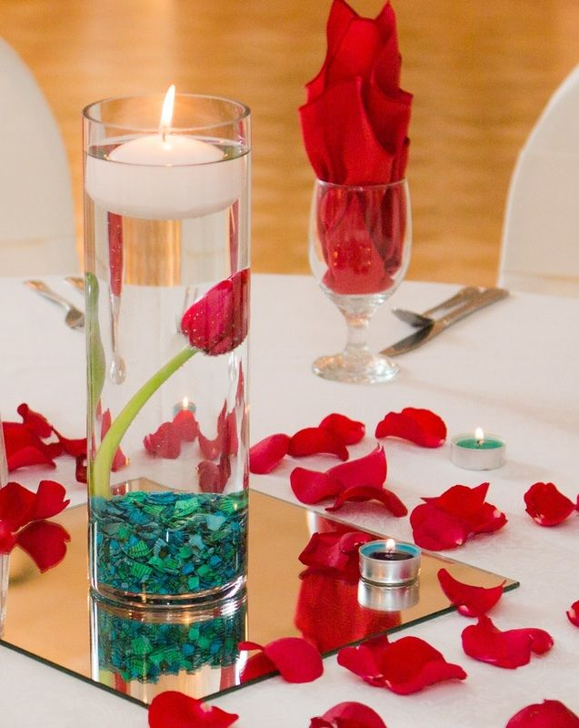 weddings floating candle centerpiece with a red tulip underwater