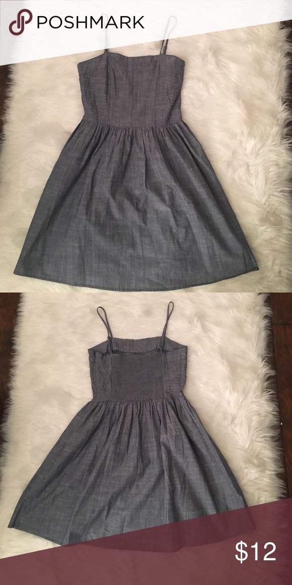 Gap Denim Dress Gap denim dress with spaghetti straps. Elastic panel in the back. Side zipper closure. GAP Dresses